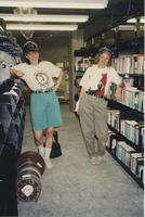 Danuta Zwierciadlowski and Sheila Wallace pose for a photo with the media collection in the South Building Library during construction, 1994.