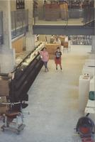 Danuta Zwierciadlowski, [Lisa?], and [?] pose in front of what will become the current journal display area in the South Building Library during construction, 1994.