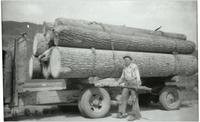 John Graham in front of a logging truck