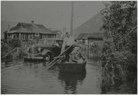 Marjorie and Ned Jackson, along with Annie Macdonald, take advantage of water transportation during the flood