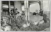 J.M Robinson and family on veranda at their home